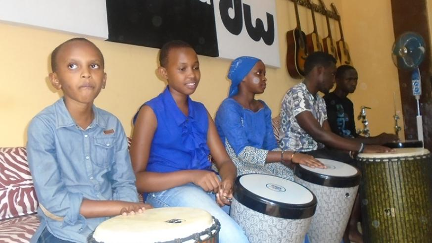 CLOCKWISE: Some of the children during a drumming session at the school last Sunday; Jaymo Mutinda, the drum instructor and director takes the children through a drum class; The ch....