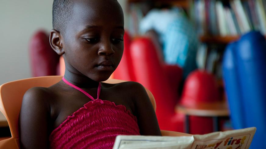 A young girl reads a book at Kigali Public Library. / File