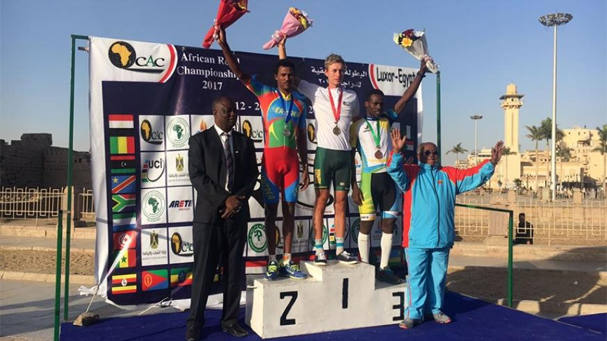 South Africa's Stefan Debod (C), Eritrea's Habton Awet (L), and Rwanda's Joseph Areruya pose with their medals at the podium yesterday. Courtesy