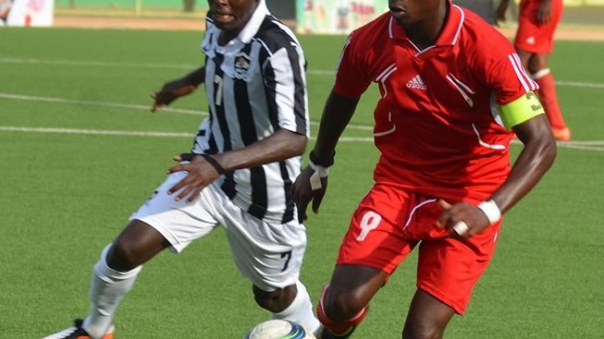 Etincelles FC striker Salita Gentil Kambale takes on APR FC midifielder Janvier Benedata in a previous game at Kigali Regional Stadium. Sam Ngendahimana.
