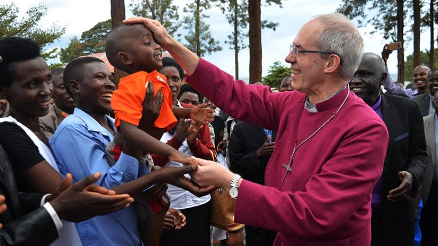 The Archibishop of Canterbury, The Most Rev. Justin Welby, blesses a child as the faithful welcome him to Gahini Diocese in Kayonza District on Saturday. (Photos by Sam Ngendahimana)