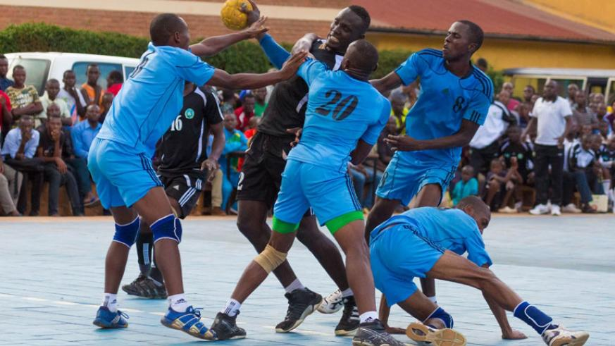 Reigning league champions Police (blue) defeated APR 40-38 to extend lead on top of the league table (File)