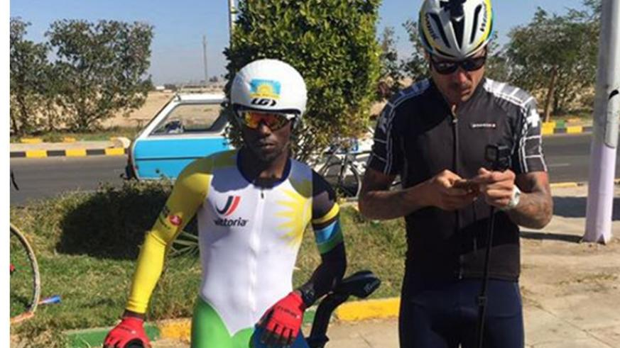 Joseph Areruya poses with Team Rwanda head coach Sterling Magnell in Egypt. Coutesy