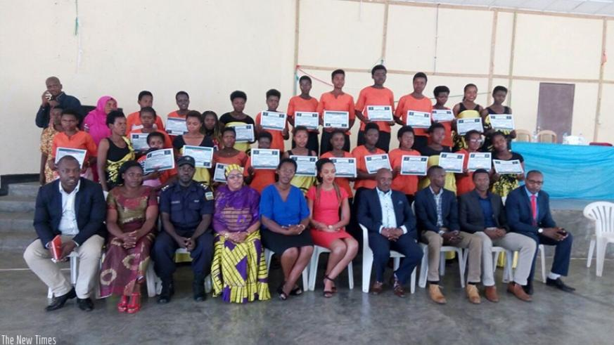 The graduates pose for a photo with Musanze district officials, Sharifa Uwumuhoza and other guests at the ceremony. / Regis Umurengezi.