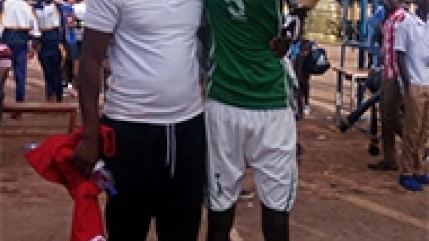 Muhirwa poses with the trophy and his coach Fidele Nyirimana after winning the Kayumba memory title Peter Kamasa