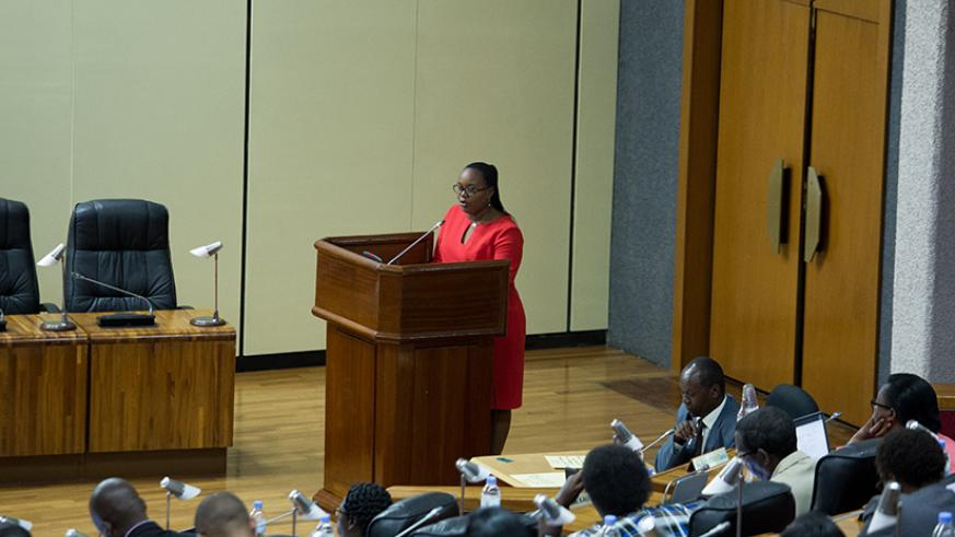 Deputy speaker of Parliament Jeanne d'Arc Uwimanimpaye presents a final report to lawmakers on Tuesday. (All photos by Timothy Kisambira)