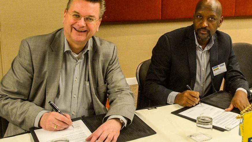 Nzamwita and his German counterpart ink the deal in Johannesburg on Wednesday. Courtesy.