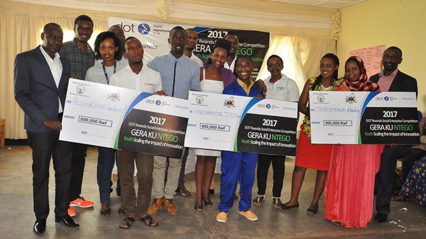 Winners in Kicukiro display dummy cheques on Thursday. Courtesy.