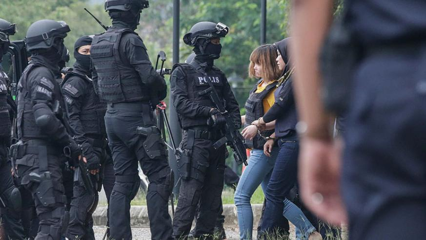 Doan Thi Huong, 28, of Vietnam was charged with murder on Wednesday in Malaysia in connection with the assassination of Kim Jong-nam, the half brother of North Korea's leader, Kim ....