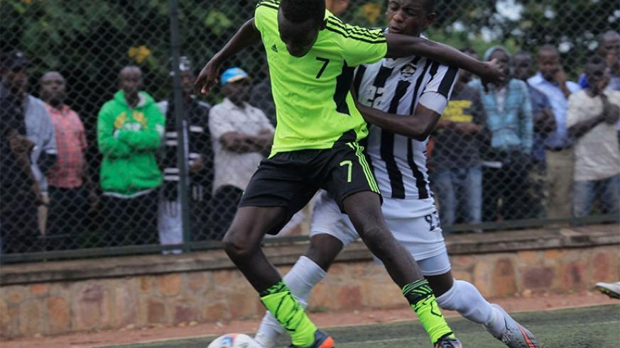 Gicumbi FC striker Seleiman Mudeyi, in action against APR FC defender  Michel Rusheshangoga, Mudeyi scored the lone goal in the 1-0 win on Wednesday.  S. Ngendahimana.