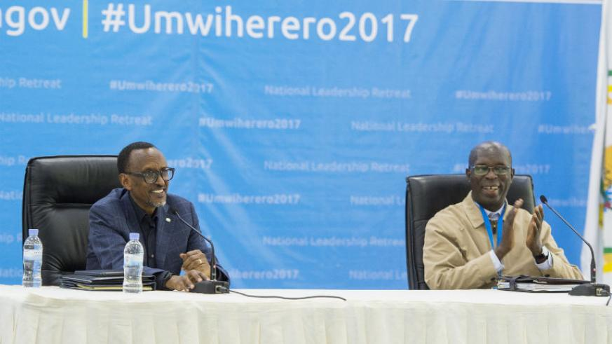 President Kagame and Prime Minister Anastase Murekezi cheer during 14th National Leadership Retreat yesterday at the Rwanda Defence Force Combat Training Centre in Gabiro, Eastern ....