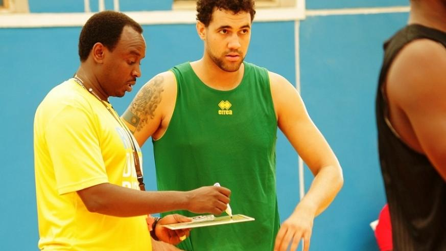 Head coach Moise Mutokambali  talkign to Bradley Cameroon during training at Amahoro Indoor Stadium on Friday. Courtesy.