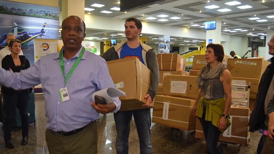 Ntavuka guides the medics at the Kigali International Airport on their arrival with medical equipment on Saturday. J. Mbonyinshuti.