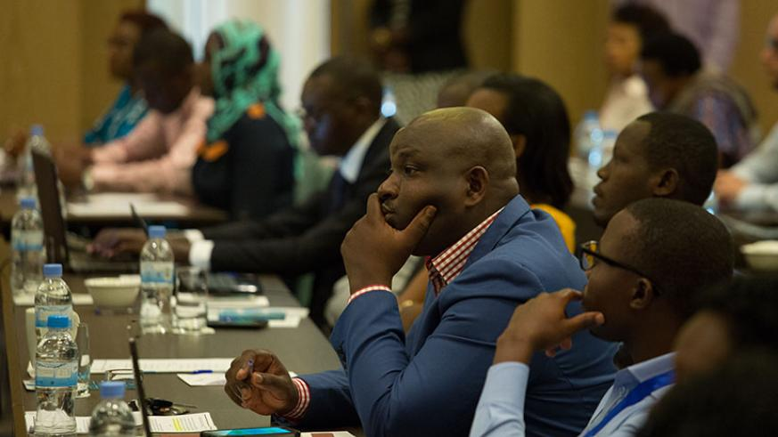 Participants at the launch of the report in Kigali last week. / Timothy Kisambira
