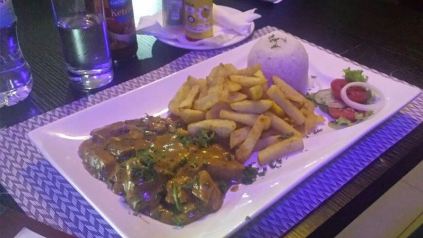 Chicken curry served with fries at The Junction. Photo by Michael Bageine.
