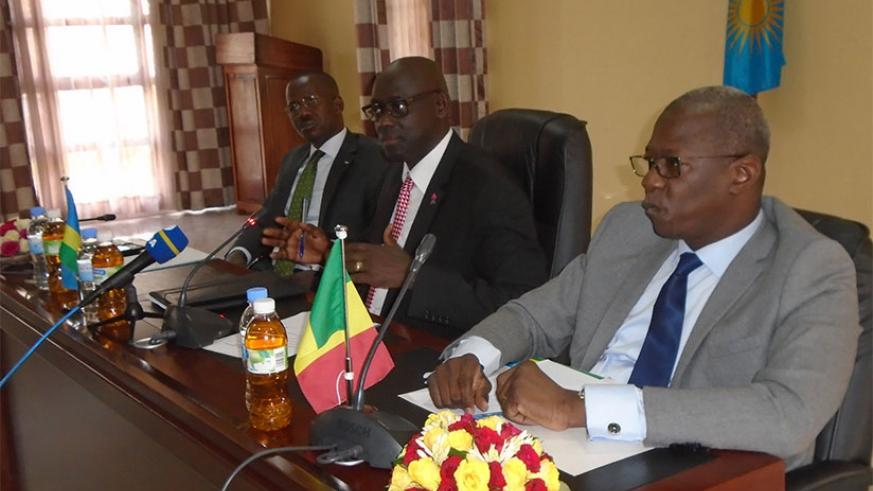 L-R: Busingye addresses the media on Thursday. Looking on are his Malian's counterpart Mamadou (R) and Evode Uwizeyimana, the State Minister for Legal and Constitutional Affairs. /....