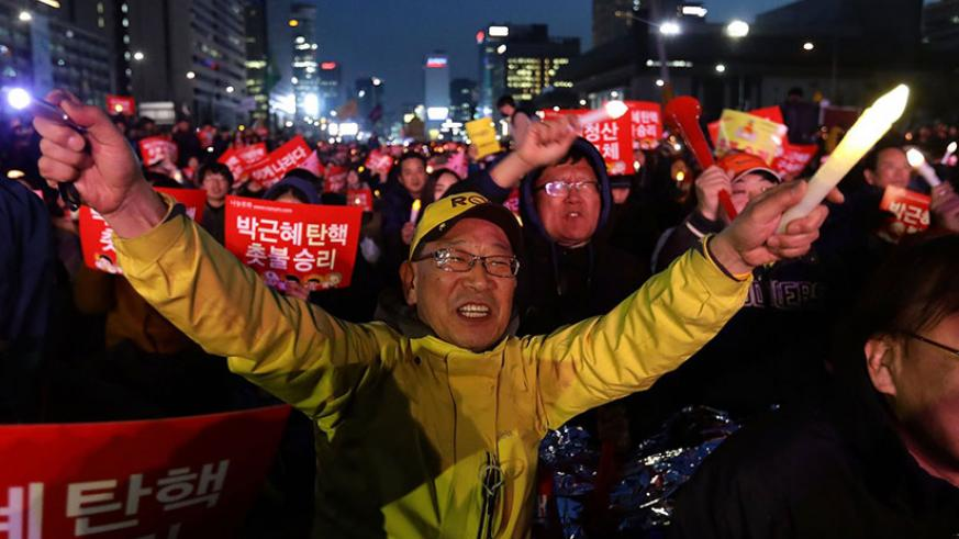 South Koreans celebrate after the constitutional court upheld the impeachment of Park Geun-hye. / Internet photo