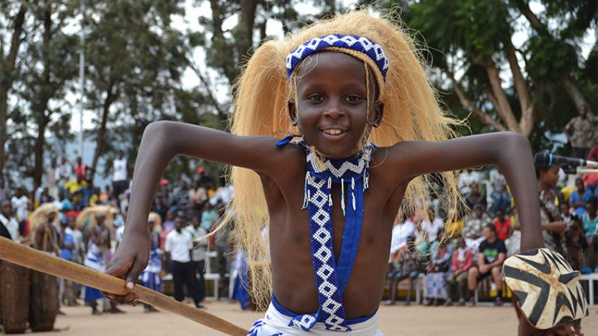 A young Intore dancer in Kigali City traditional troupe Indatirwabahizi.