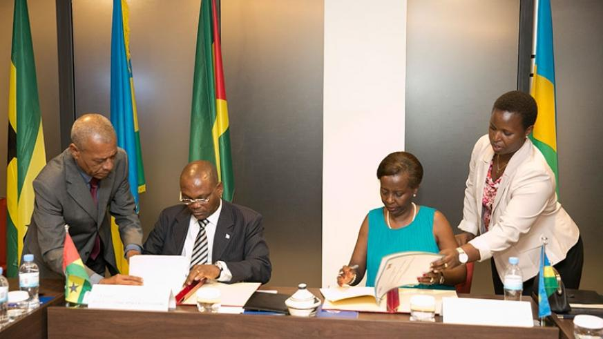 Mushikiwabo (R) and Botelho sign the agreements at the weekend. Courtesy.