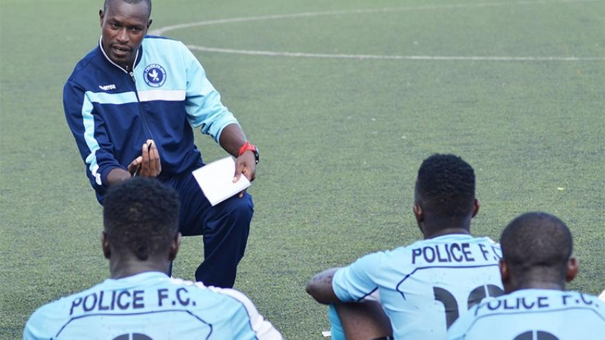 Police head coach Innocent Seninga gives instructions to his players during a recent league match. Sam Ngendahimana.