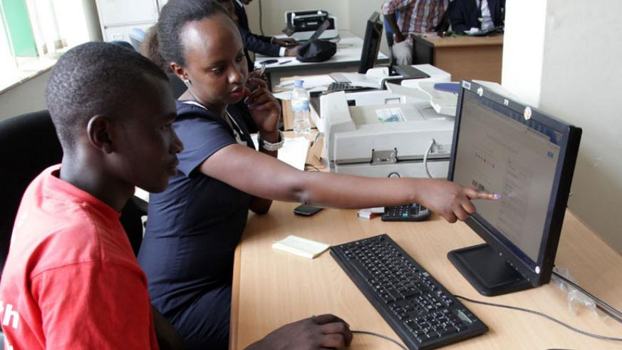 An RDB staffer guides a client on how to register business online. / File