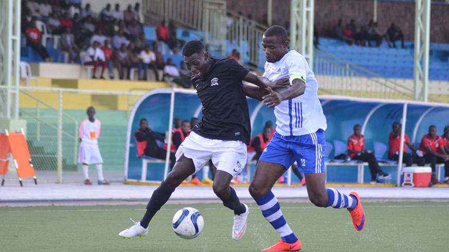 APR midfielder Janvier Benedata battles for possession with Pepiniere captain Omar Hitimana during the first round encounter. / Sam Ngendahimana