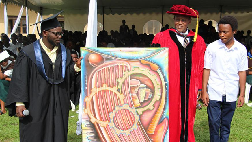 Dr Vuningoma receives a gift from the school. The art piece was drawn by one of the students in visual art (in school uniform)