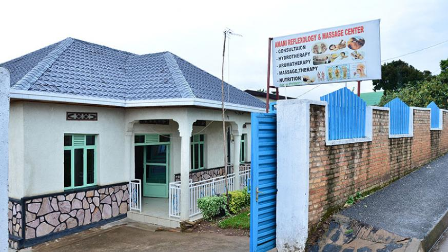 The premises of Amani Reflexiology Centre in Muhanga District. Inset, a flyer advertising the 'wonders' the MMS chemical mixture that Amazing Health Recovery House is alleg....