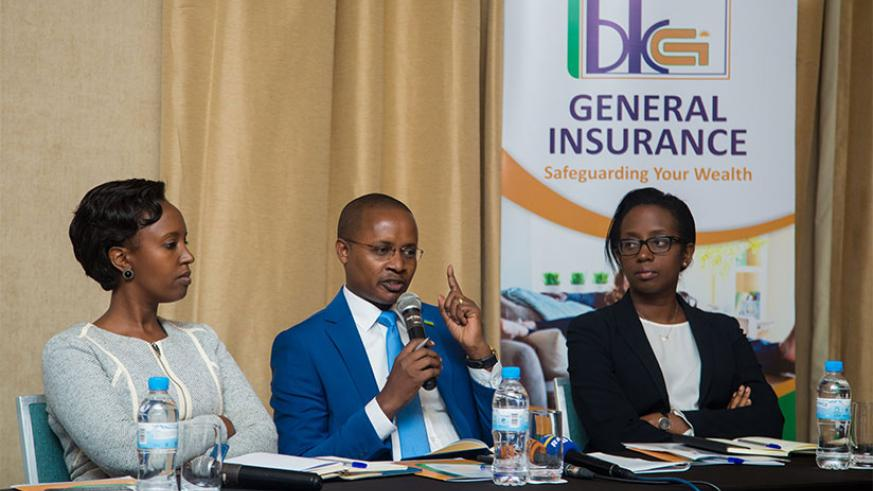BK General Insurance CEO Alex N. Bahizi, flanked by other BK officials, speaks to journalist at the launch of the new insurer last week. File