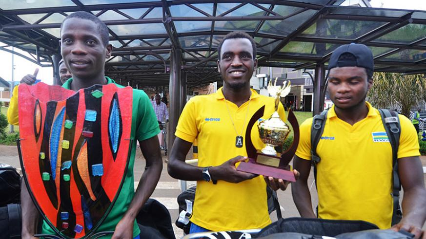 L-R: Jean Bosco Nsengimana, who won the king of the mountains award; Valens Ndayisenga, the best young rider, and Bonaventure Uwizeyimana on arrival at Kigali International Airport. / File