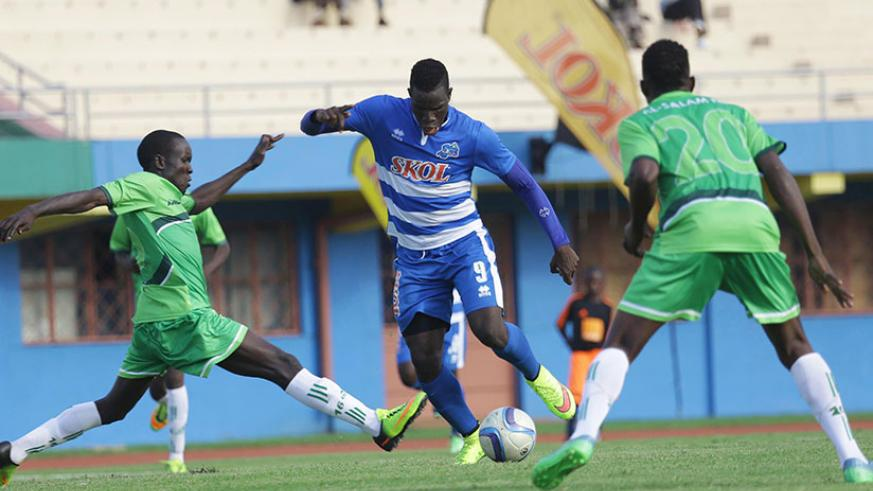 Rayon's striker Moussa Camara tries to dribble past South Sudan's Al-Wau Salaam players during the CAF Confederation Cup first round second-leg match at Amahoro Stadium. The Rwanda....