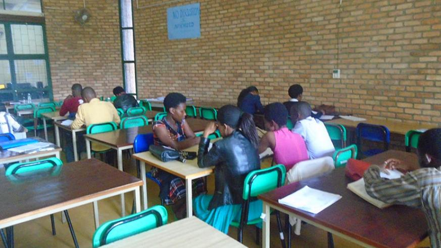 Students do revision in a library. Reading literature in English is one way to improve proficiency. / Lydia Atieno