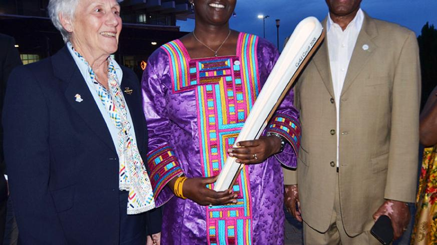 L-R: Commonwealth Games Federation President Dr Louise Martin, Minister for Sports and Culture Julienne Uwacu and National Olympic president Amb. Valens Munyabagisha pose for a pho....