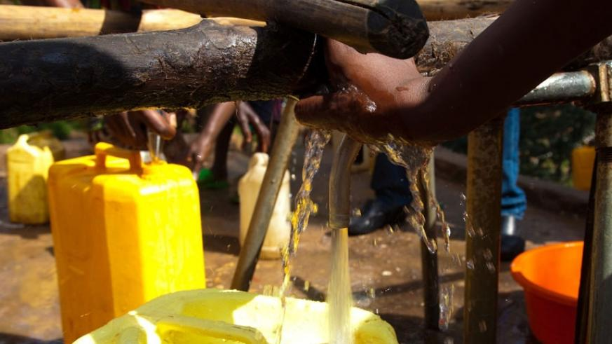People fetch water in Karongi District. File.