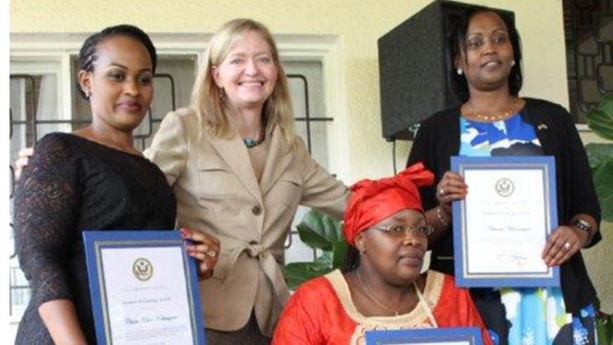 Amb. Barks-Ruggles (2nd L) pose for a group photo with the winners on Wednesday. Courtesy.