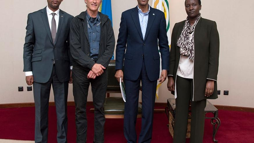 President Kagame meets with official from the Rwanda Cycling Federation; Aimable Bayingana, the president (L), and Team Rwanda technical director Jonathan Boyer (second-left), and ....