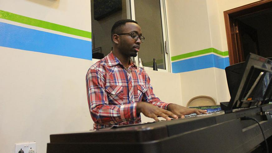 Ndahiro rehearsing with the rest of the ensembles.