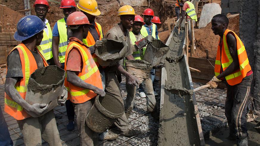 Builders on a construction site in Kigali. The government wants to reduce importation of constructions materials like cement . / Timothy Kisambira