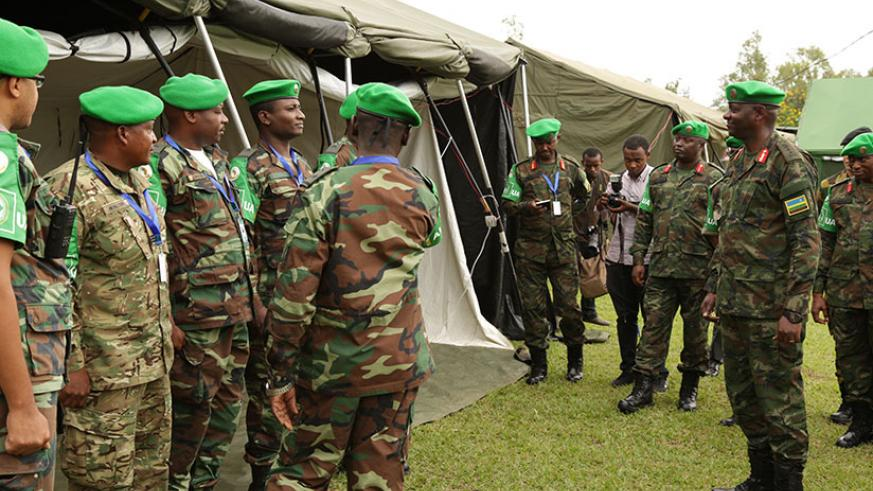Maj Gen Jacques Musemakweli, Army Chief of Staff of the Rwanda Defence Forces (RDF), inspects the Angolan Contingent's base at the opening of the 3rd Command Post Exercise (CPX) of....
