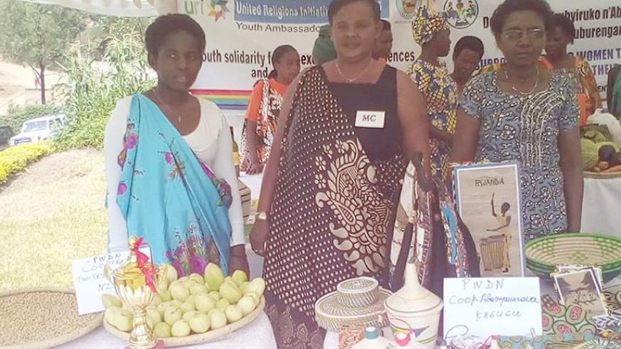 Mukantabana (center) during an exhibition with the beneficiaries.