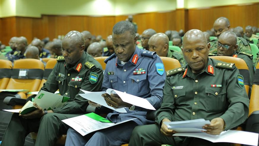 Senior RDF officers and members of Zigama-CSS read through the agenda during the meeting at RDF Headquarters in Kimihurura. File.