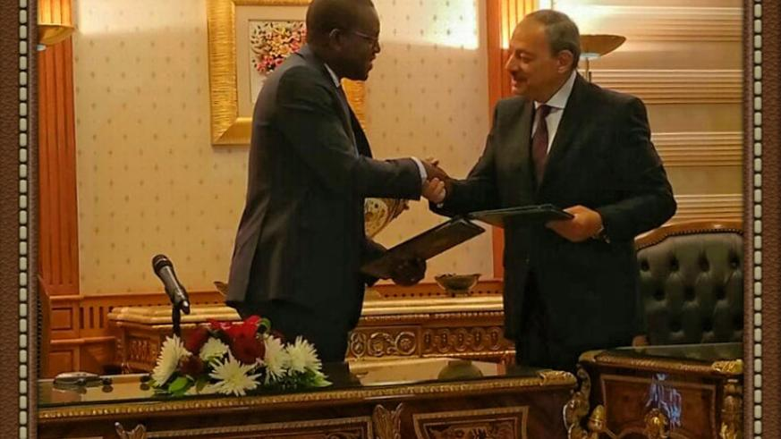 Mutangana (L) shakes hands with  his Egyptian counterpart Nabeel Ahmed Sadek after the two signed the Memorandum of Understanding in Cairo, on Thursday. Courtesy.