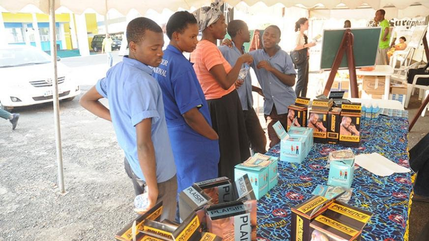 People inquire about different forms of contraception during a past event on reproductive health. File.