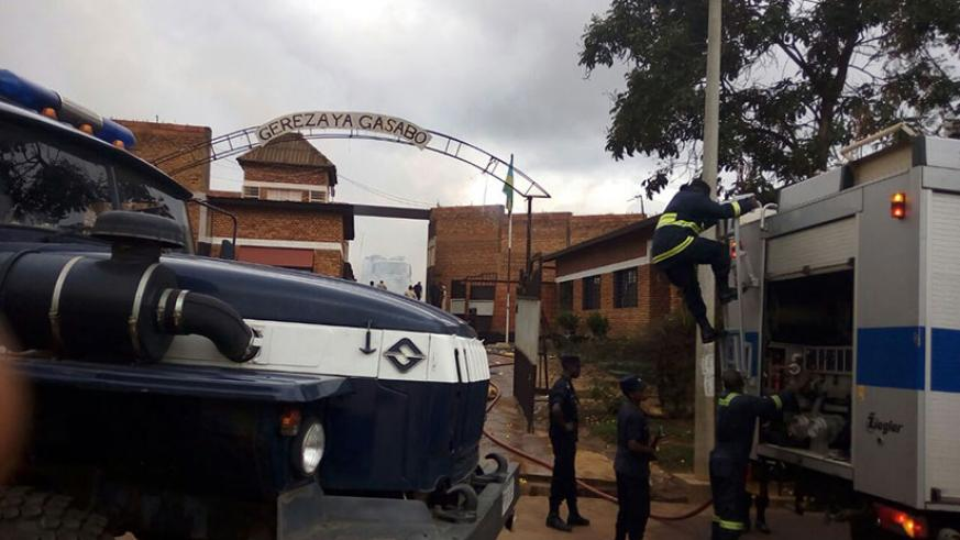 Firefighters arrive at Gasabo Prison in to help put out the fire. / Jean d'Amour Mbonyinshuti