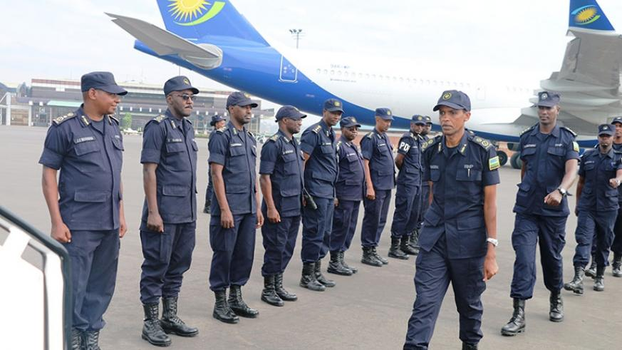 ACP Rangira leads the officers as they prepare for departure at Kigali International Airport. (Courtesy)