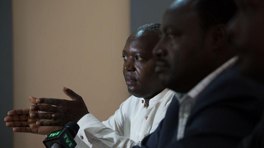 Munyamaliza (L) speaks in Kigali yesterday. (T.Kisambira)