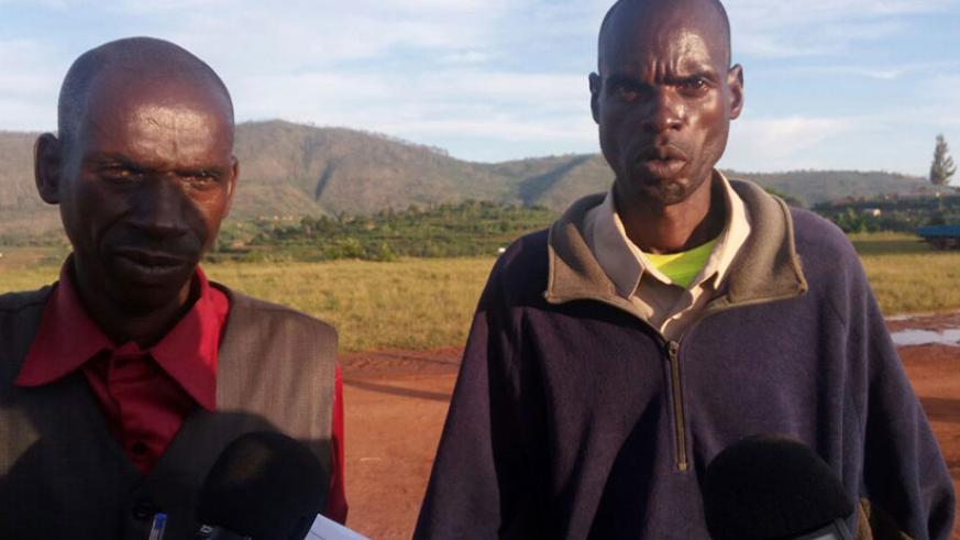 The two men, Ndorande (L) and Hakizimana (R), stood side by side in front of locals and announced they had decided to move on. / Remy Niyingize