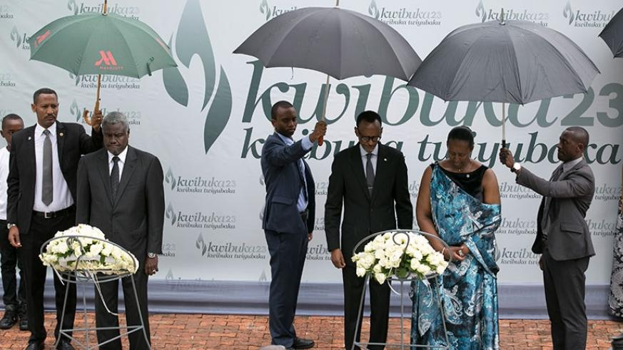 President Kagame and First lady Jeannette Kagame, and the African Union Commission Chairperson Moussa Faki Mahamat (L) lay wreaths in honour of the Genocide victims at Kigali Genoc....
