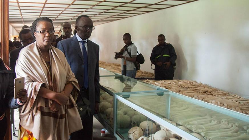 Chief Justice Sam Rugege, Dr Geraldine Mukeshimana,Minister for Agriculture and other officials look at the retrieved remains of genocide victims at Nyarubuye Genocide Memorial, in....
