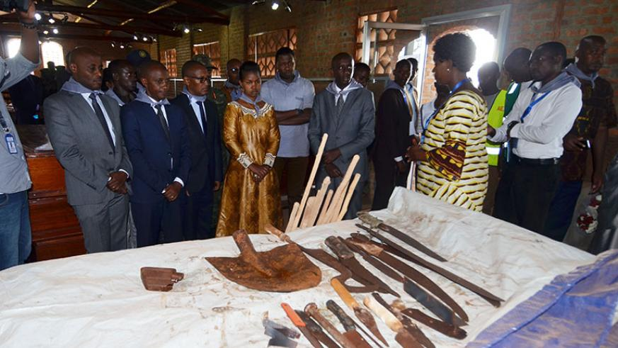 Kaboneka and other officials look at some of the tools that perpetrators used to butcher the Tutsi inside Ntarama Catholic Church in Bugesera District. / Sam Ngendahimana